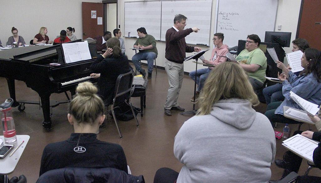 Dale Heidebrecht, assistant music professor, leads the cast of UrineTown in their first rehearsal, Tuesday Dec. 5, 2017. Photo by Francisco Martinez