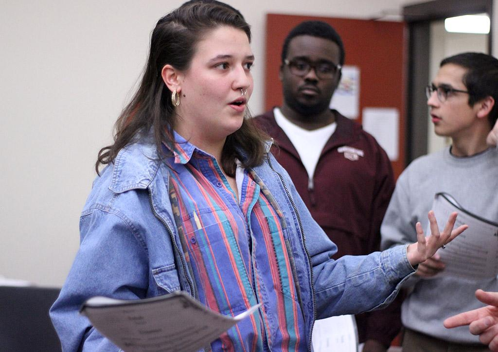 Ellanor Collins, theater senior, practices hitting her character's notes during the first rehearsal of UrineTown. Photo by Rachel Johnson