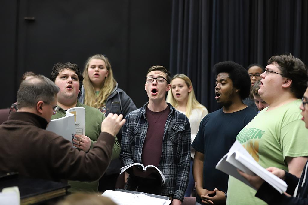 """Cast members for """"Urinetown"""" practice lines at rehersals in the Bea Wood Theatre on Jan. 17. Photo by Latoya Fondren"""