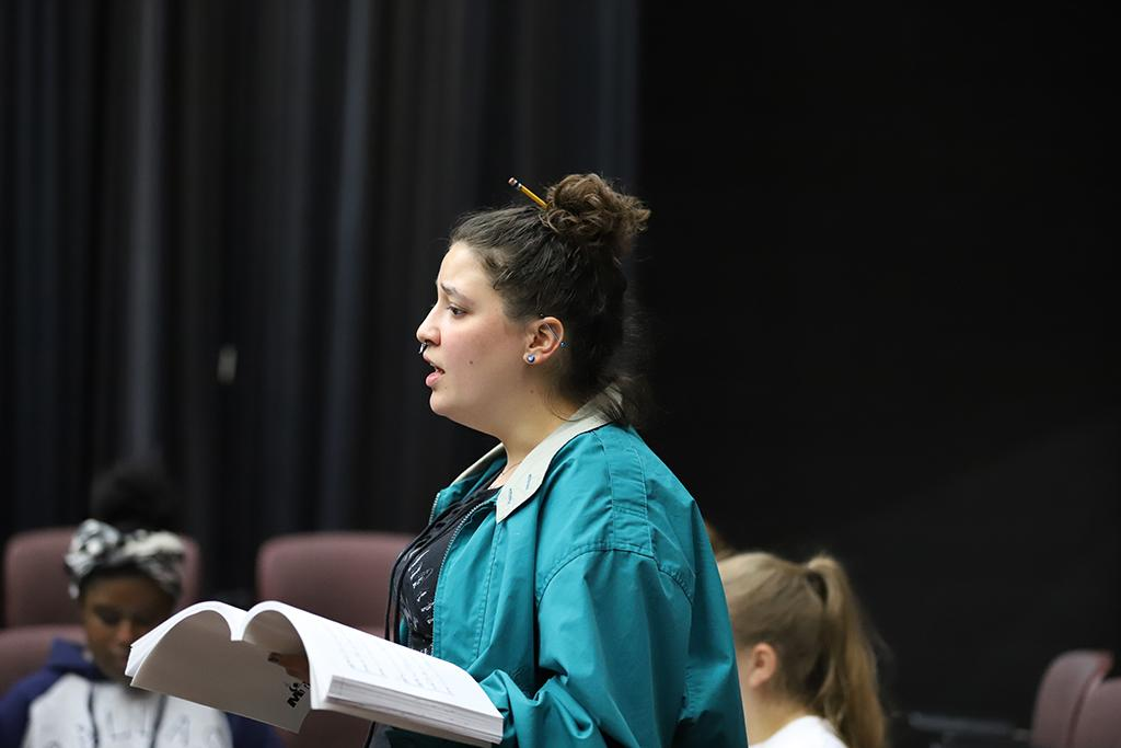 """Ellanor Collins sings at rehearsal for the production of """"Urinetown"""" on Jan. 17. Photo by Latoya Fondren"""