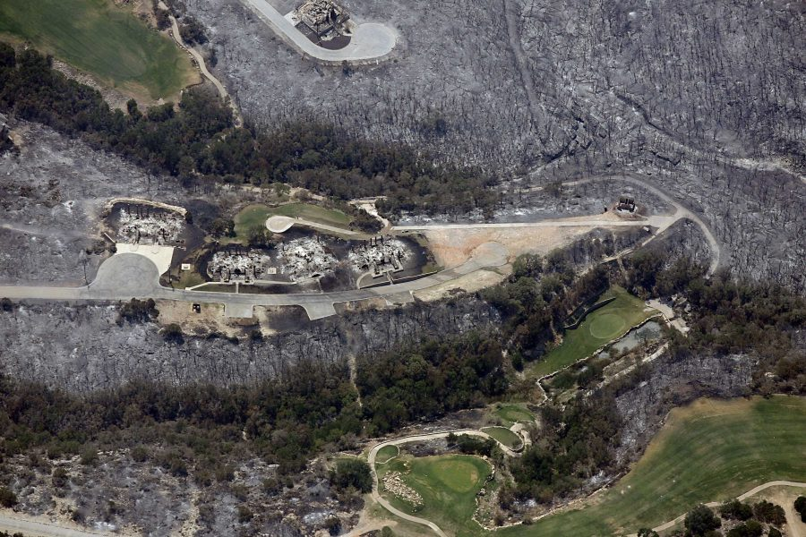 A+golf+course+is+surrounded+by+burned-out+homes+and+scorched+grass+and+trees+in+this+aerial+photograph+taken+near+Possum+Kingdom+Lake%2C+Palo+Pinto+County%2C+Texas+on+Thursday%2C+September+1%2C+2011.+%28Ian+McVea%2FFort+Worth+Star-Telegram%2FMCT%29