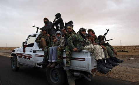 Rebel Fighters crowd a truck as they leave Bin Jawwad, Libya, on March 29, 2011. (Luis Sinco/Los Angeles Times/MCT)