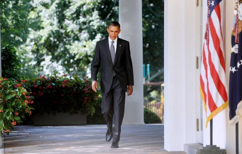 U.S. President Barack Obama walks into the Rose Garden before delivering a statement urging lawmakers to extend legislation to fund highways and mass- transit projects, Wednesday, August 31, 2011, in Washington, D.C. (Olivier Douliery/Abaca Press/MCT)