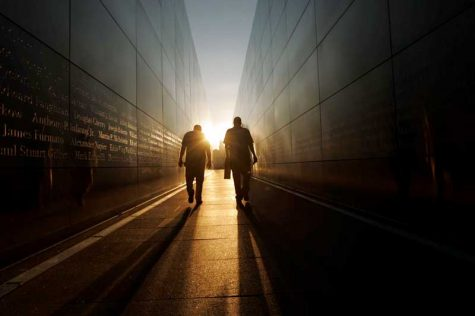 Two men walking toward the sun at the 9/11 memorial at Liberty State Park in New Jersey. Photo by Kevin Wexler/MCT