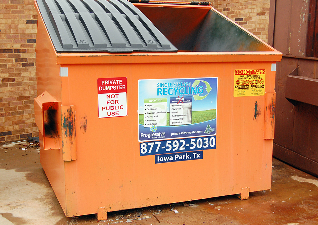 2013 file photo of an orange recycling bin on campus