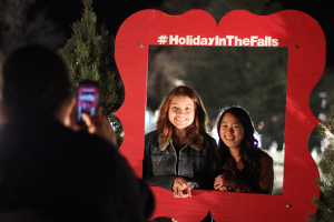 Kasey Chin, dental hygiene freshman, and Samantha Flores, psychology freshman, have thier picture taken at the MSU-Burns Fantasy of Lights opening ceremony Monday night in the front lawn of the Harden Administration building. The fantasy of lights has individual displays with themes or characters from children's stories, fairy tales and holiday themes. The fantasy of lights display opened early this year before Thanksgiving and will continue through Dec. 28. The lights turn on at dusk and turn off at 10 p.m. Sunday through Thursday and 11 p.m. Friday and Saturday. Photo by Lauren Roberts