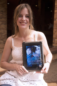 Kendell Penington, sophomore  in English, with her first published book — The Guardians: The Lost Realm.