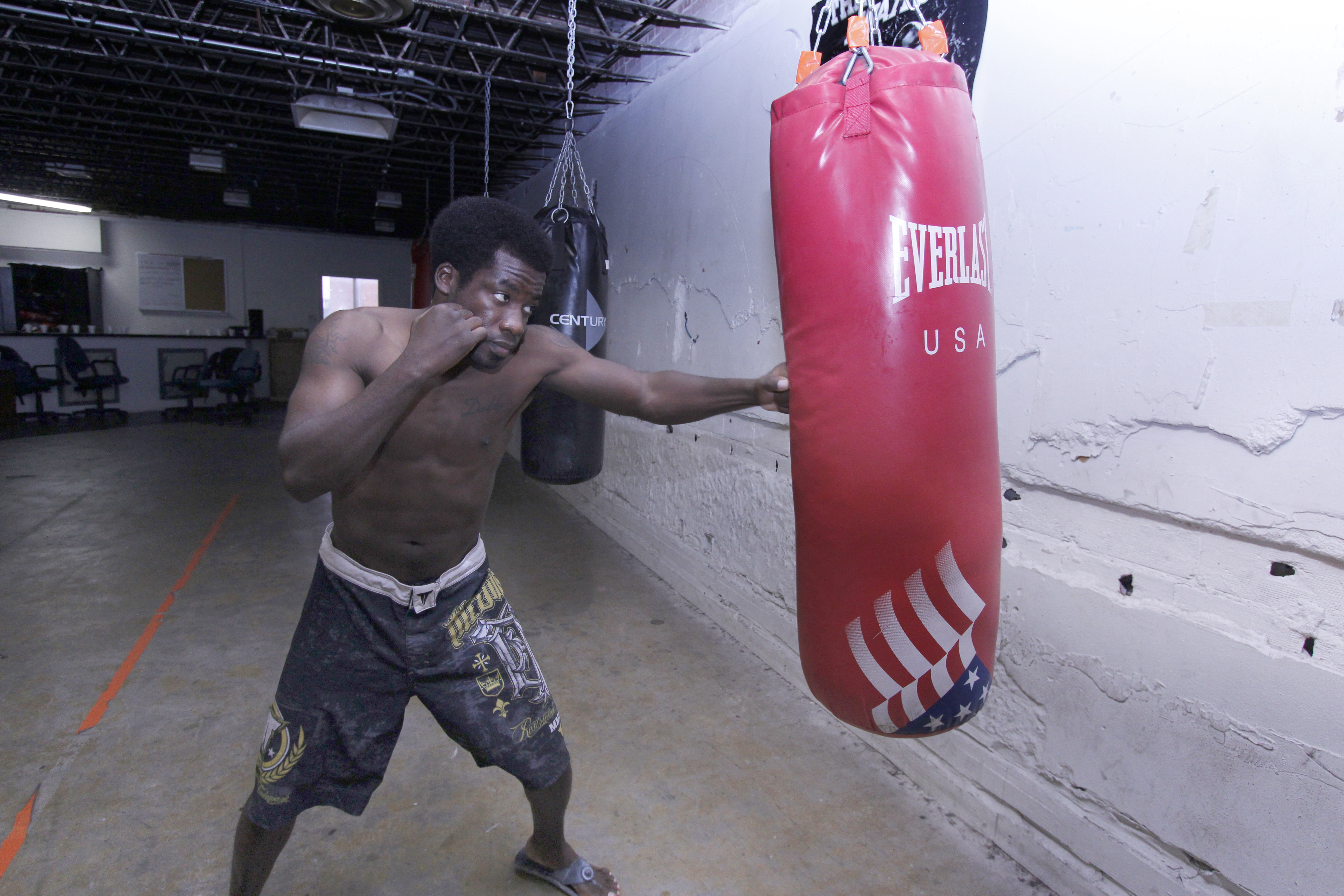 """Tolu """"Techdaddy"""" Agunbiade hits the bag during training at Falls Town Fight Club. Agunbiade fought at The King of the Cage World Amateur Championship on Oct. 19 in Las Vegas. Agunbiade's next fight will be a grappling match at Newberry in Dallas on Nov. 7."""
