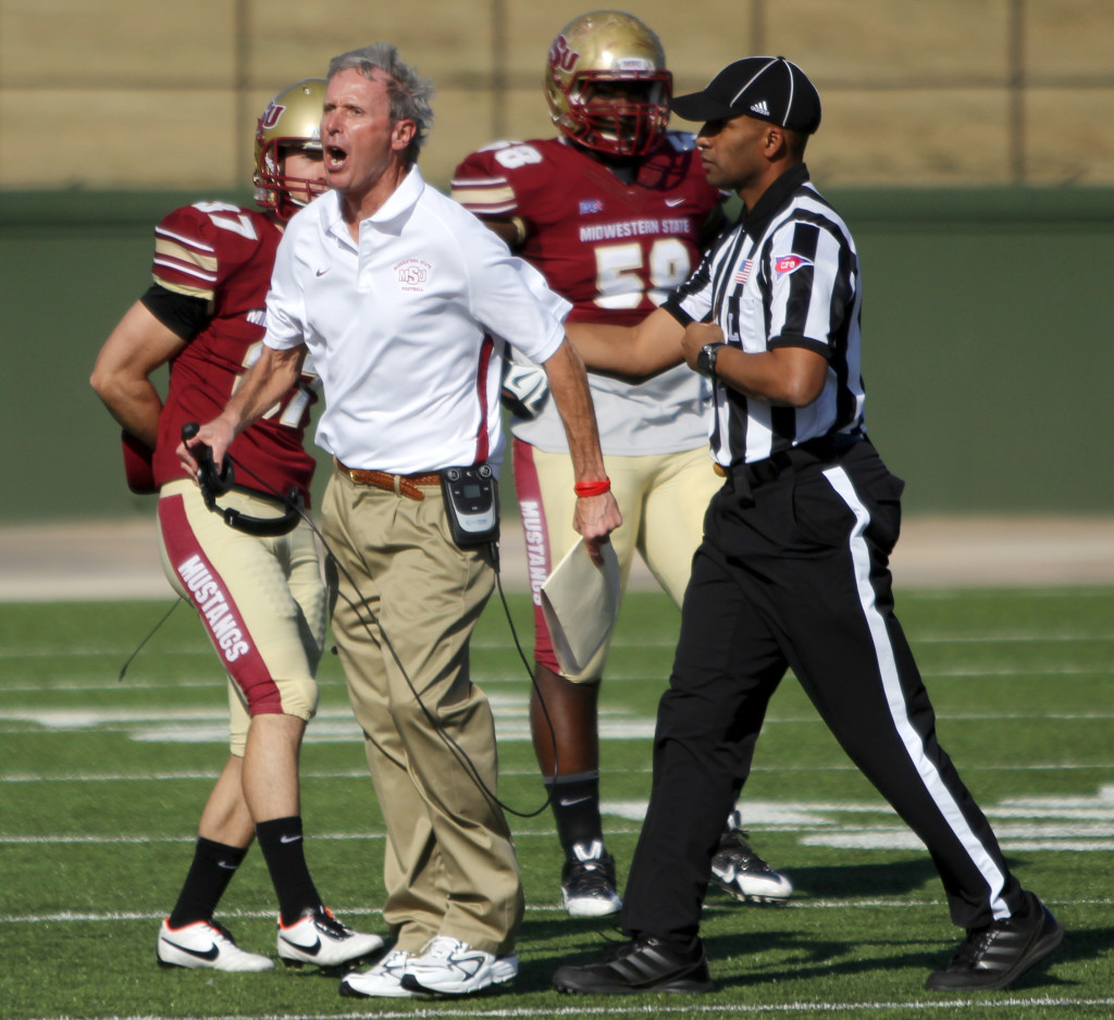 Head Coach Bill Maskill argues with officials after running back Keidrick Jackson gets drilled into the ground by a West Texas A&M defender Nov. 16 at Memorial Stadium. The Mustangs would lose 12-19 taking their conference record to 3-3 with an overall record of 7-3.