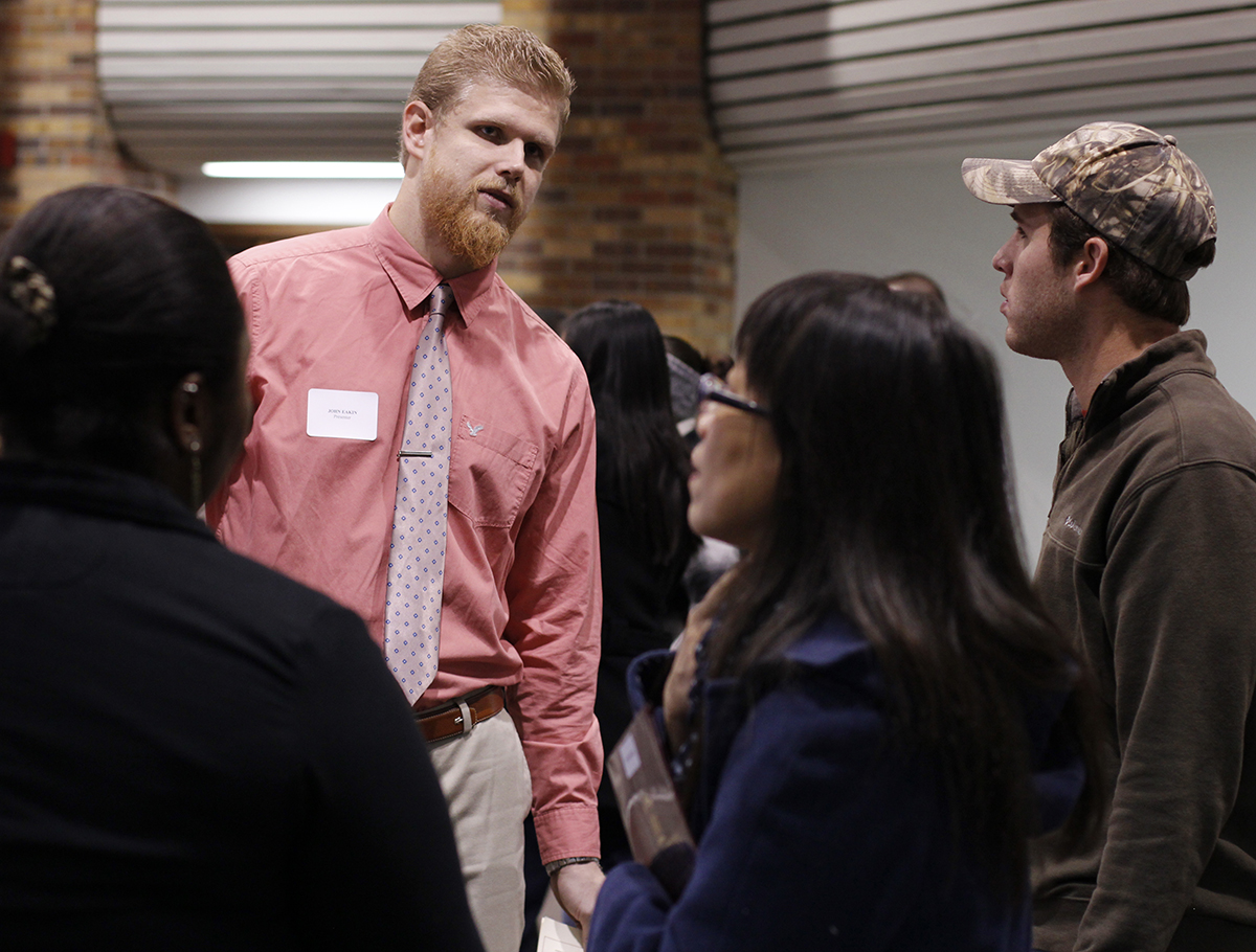 In the Clark Student Center atrium Nov. 22 students presented the research they completed over the summer for the undergraduate research opportunities and summer workshop. John Eakin talks to David Lovelace about the research he did with Algerr Remy over seed dormancy. Lovelace said,