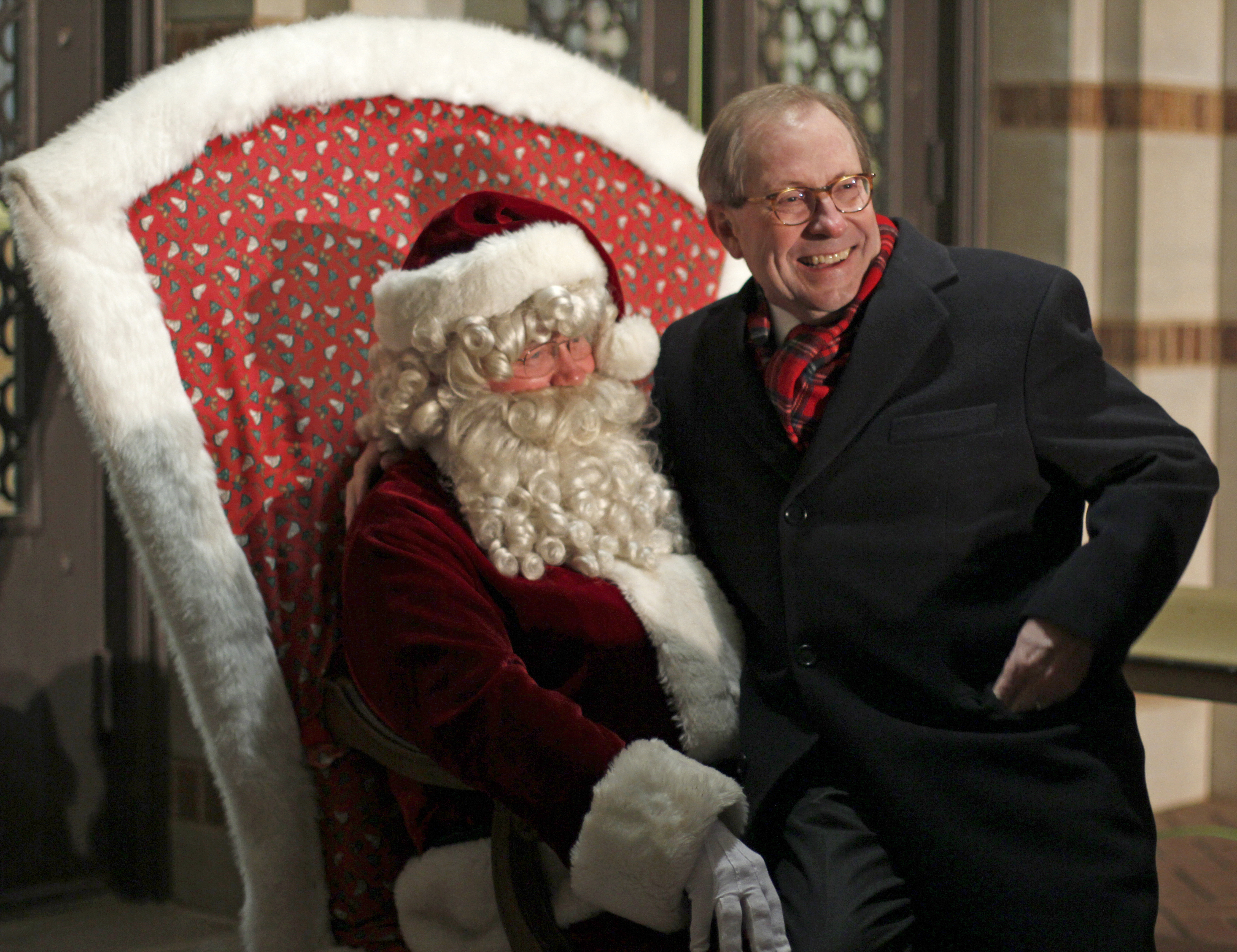 University President Jesse Rogers sits on Santa's lap at the Fantasy of Lights opening Dec. 10.