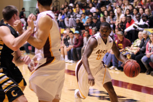 Monzaigo Williams, senior in socail work, gets around the Cameron University defense to score Saturday night. The game went into overtime where MSU defeated Cameron 70-67. Photo by: Lauren Roberts