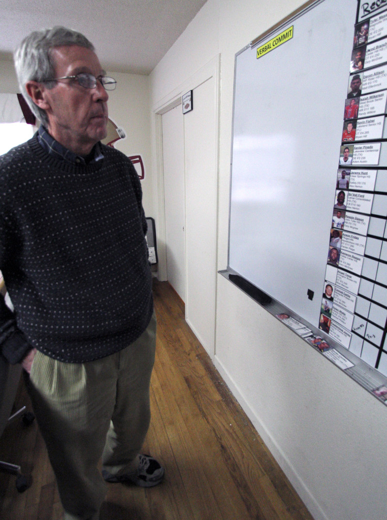 Head Football Coach Bill Maskill looks at the recurit board Tuesday afternoon in the football offices along Hampstead. Photo by Lauren Roberts