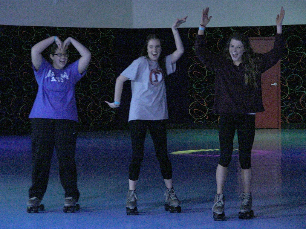 "Mikayla Morrison, freshman in phychology, Peydon Stivrs, frashman in radiology, and Destiny Zynda, frashman in exercise physiology, attempt an  'MSU' formation on the skating rink at BSU's Roller Bounce event on Feb. 13. Zydna said, ""I saw the poster in the hall and thought, 'Hey, free skating!'"""