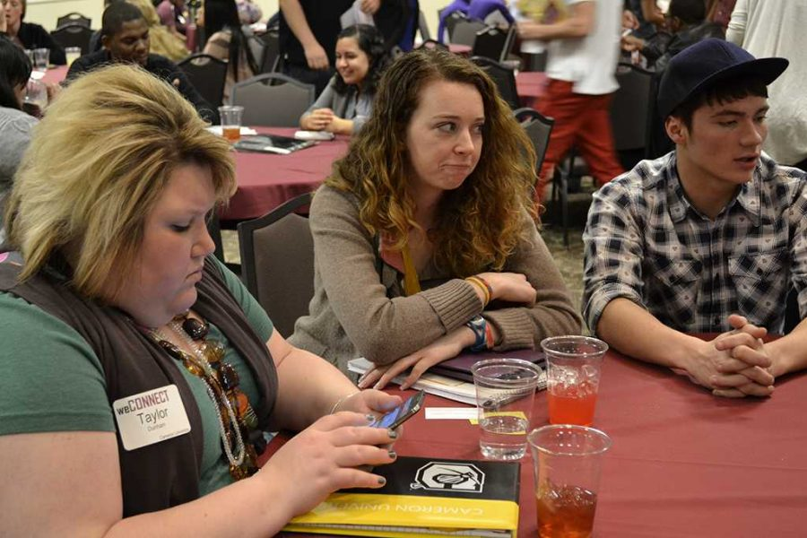Taylor Dunham, junior in art, Kailee Williams, junior in social studies, and Tim Thompson, freshman in multimedia design, wait for the second breakout session at the WeConnect Conference on Feb. 22.