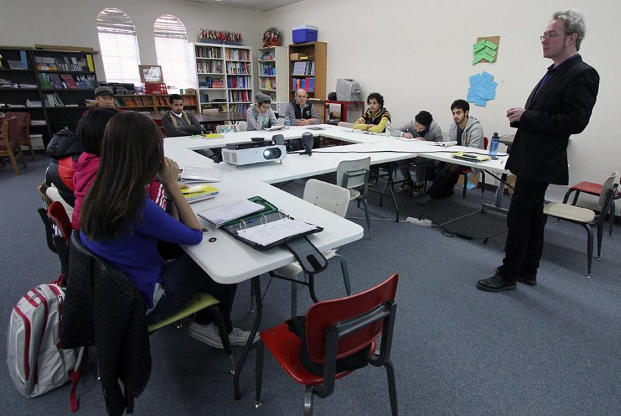 Tench Coxe, program coordinator of intensive english language institute, speaks to his class Monday morning in Harden about their spring break. Photo by Lauren Roberts
