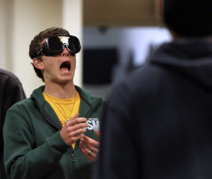 Michael Lamberti, freshman in mechincal engineering, tries to catch a ball at the sobriety test booth ran by the police department at safe spring break held in the Clark Student Center Comanche Suite Tuesday afternoon. Photo by Lauren Roberts