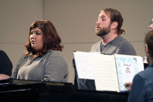 Emily Clements, junior in vocal performance, and Budy Ricardson, junior in percussion performance, sing during the final rehearsal for the spring choral concert Tuesday afternoon in Akin Auditorium. Photo by Lauren Roberts