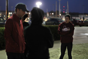 Ashley Flores, junior in sociology, listens as head track coach Koby Styles tells the team what drills to run on the teams last practice before leaving for the Indoor Track Championship in Lubbock Friday morning. Photo by Lauren Roberts