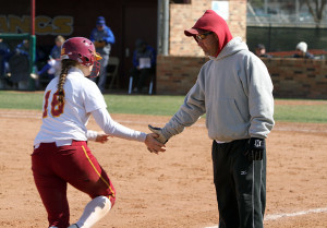Kim Jerrick, senior in physical therapy, gets a low-five from head softball coach Brady Tigert after hitting a three-run homerun in the final inning. The softball team defeated Texas A&M-Kingsville 16-5 in the final game of the four-game series at Mustang Field. The team is 11-1 in Lone Star Conference play. The next series is against Angelo State University Friday and Saturday in San Angelo. Photo by Lauren Roberts