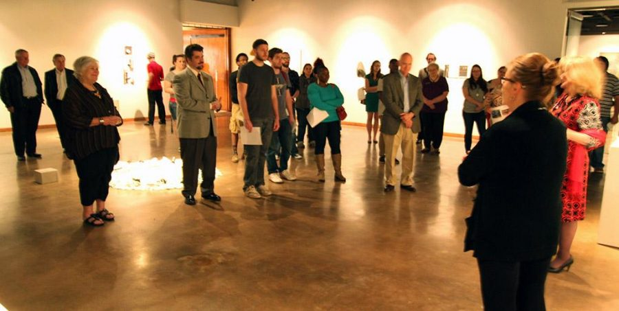 Marla Ziegler gives the gallery talk on her sculpture exhibit to crowd of about 30 students, faculty and community members for the opening reception at the Wichita Falls Museum of Fine Art at Midwestern State University. Photo by Ethan Metcalf.