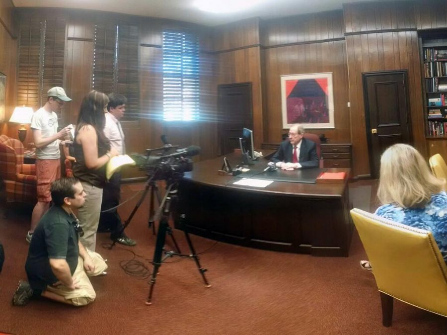 University President Jesse Rogers talks with members of the media May 9 in his office after announcing his resignation to the Board of Regents. Photo by Lauren Roberts.
