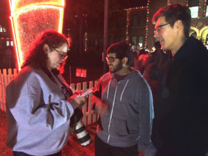 Kara McIntyre interviews students at the Fantasy of Lights in 2016. Photo by Bradley Wilson.