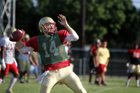 Quade Coward passes during a drill at practice Thursday at the practice fields. Photo by Lauren Robert.