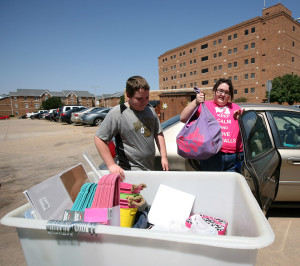 Ashley Roberts, freshman in biology, packs her things with the help of her brother, Robinsion Roberts. Photo By Yasmin Persaud