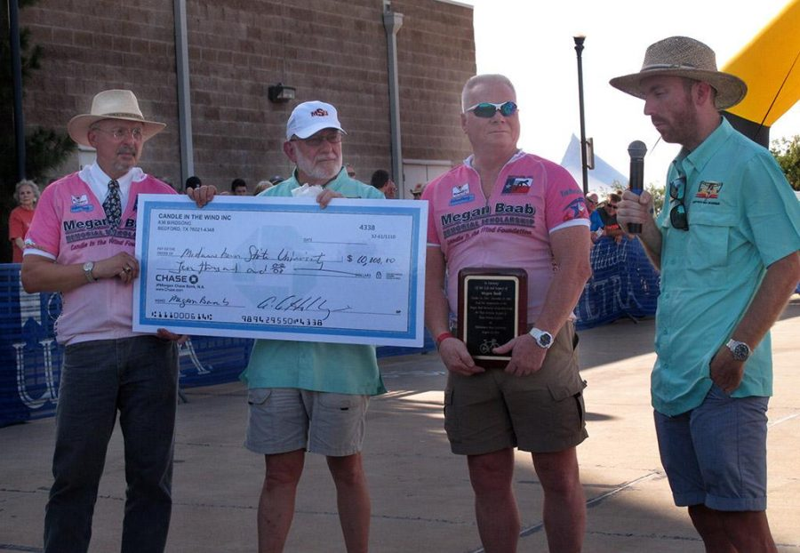 Andy Hollinger, The Racing Post editor, Robert Clark, vice president of administration and institutional effectiveness, Chris Baab, Megan Baab's father, and Charlie Zamastil, director of cycling, present the $10,000 check to Midwestern State University before the start of the Hotter'n Hell women's criterium Friday.