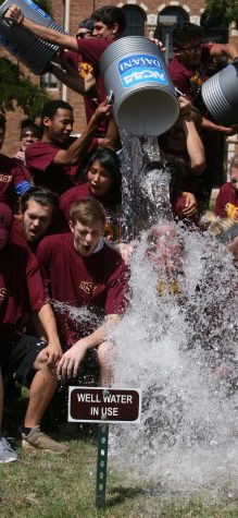 Midwestern State University President Jesse Rogers gets water dumped on him with students as part of an effort to raise money for Amyotrophic lateral sclerosis, commonly called Lou Gehrig's disease. Rogers took the challenge from officials at West Texas A&M and passed the challenge along to Angelo State University. Photo by Bradley Wilson.