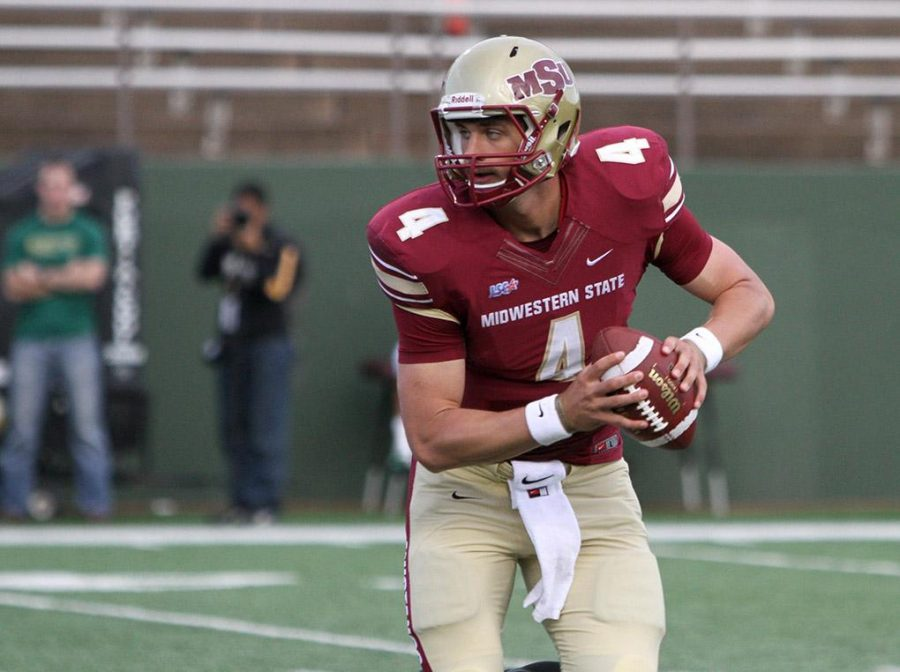 Quarterback Jake Glover, accounting senior, runs while looking for an opening at the season opener against Missouri University of Science and Technology. Midwestern State University defeated Missouri S&T 40-23 Saturday night at Memorial Stadium. Photo by Lauren Roberts