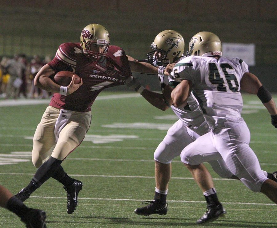 Jake Glover, accounting senior, is pulled down near the endzone at the season opener against Missouri University of Science and Technology. Midwestern State University defeated Missouri S&T 40-23 Saturday night at Memorial Stadium. Photo by Lauren Roberts