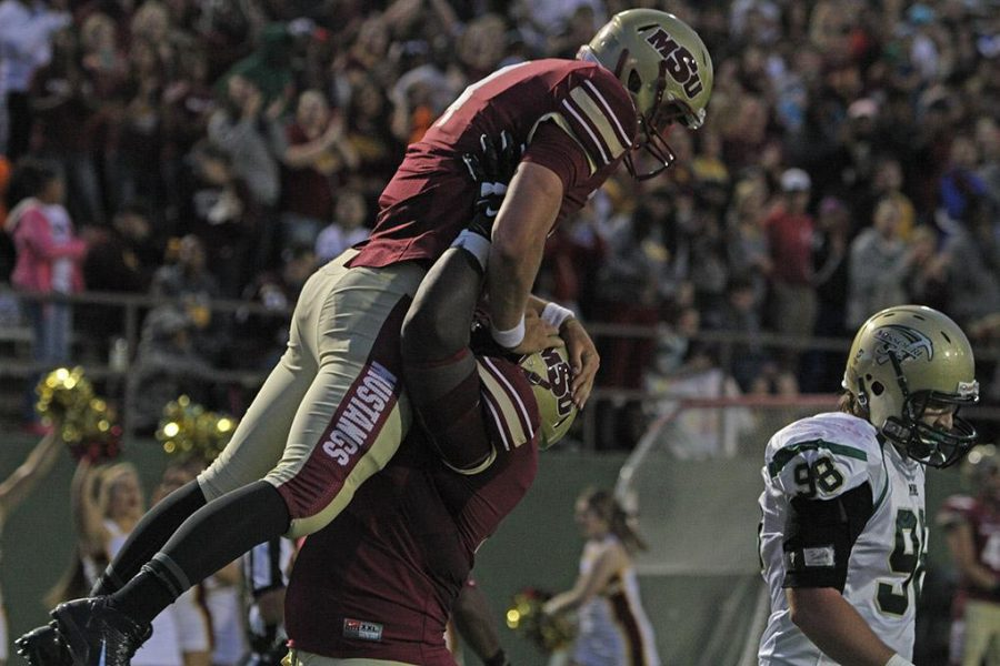 Joel Onyia, nursing sophomore, picks up Jake Glover, accounting senior, after Glover scored a touchdown at the season opener against Missouri University of Science and Technology. Midwestern State University defeated Missouri S&T 40-23 Saturday night at Memorial Stadium. Photo by Lauren Roberts