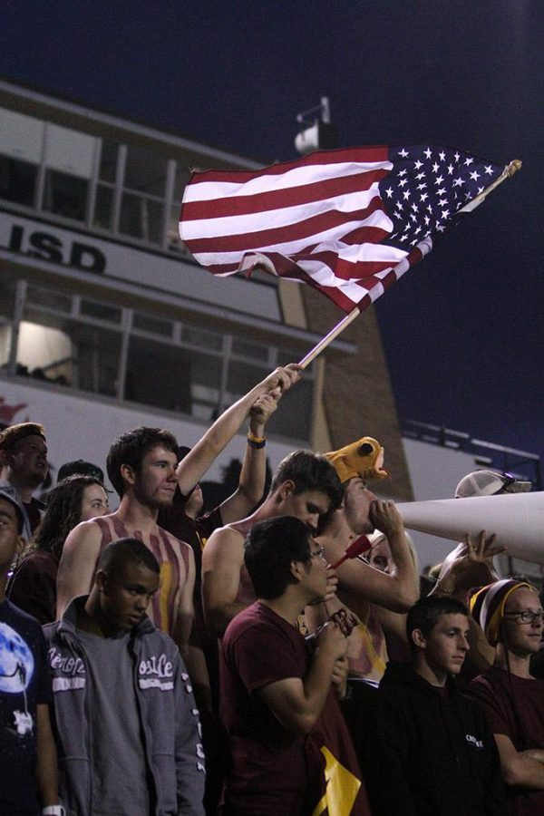 A student in the student section waves the American flag at the season opener against Missouri University of Science and Technology. Midwestern State University defeated Missouri S&T 40-23 Saturday night at Memorial Stadium. It was Military Appreciation Day for the season opener. Photo by Lauren Roberts