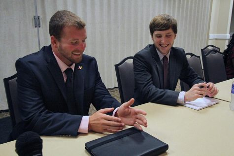 Jesse Brown, junior in criminal justice and business, and Matt Milholloe, junior in finance, converse during the Student Government Association's first meeting Sept. 3. Photo By Yasmin Persaud