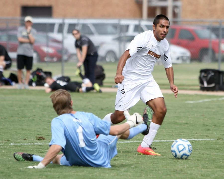 Albert Rodriguez, criminal justice junior, makes it past the goalie to score in the first half against Colorado-Colorado Springs Saturday afternoon at the soccer field. MSU won 2-0. Photo by Lauren Roberts