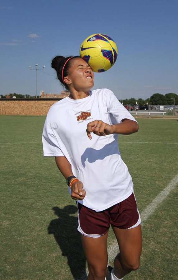 Destinee Williamson, criminal justice freshman, poses on the soccer field Tuesday. Photo by Lauren Roberts