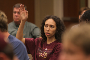 Elascha Hicks, mass communication junior, raises her hand to give her opinion on what Academic Search should look for when selecting presidential candidates in Dillard College of Business Administration Monday. Photo by Lauren Roberts