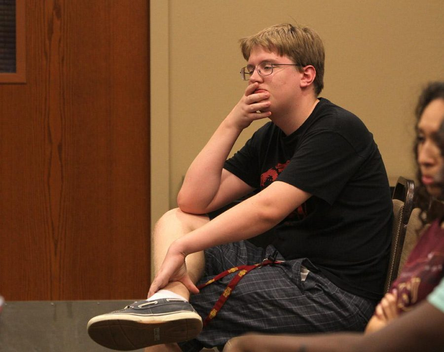 Alex J Van Allen, history junior, listens to the discussion between students and the academic search team about the qualities of the next president Monday in Dillard 189. Photo by Lauren Roberts