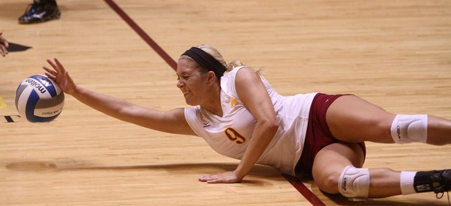 Nicole Marzik, accounting junior, dives for the ball at D.L. Ligon Coliseum Saturday afternoon against Angelo State. MSU lost 1-3. Photo by Lauren Roberts