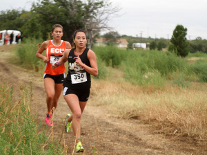 Gabby Ruiz, nursing and spanish senior, runs at the annual Strohman Dental/MSU Stampede Saturday morning at the former Hawk Ridge Golf Course. Photo by Lauren Roberts