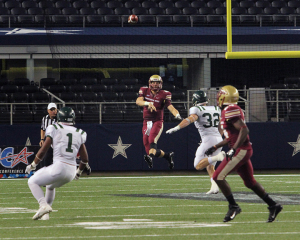 Jake Glover, quarterback, throws the ball at Midwestern State University v. Eastern New Mexico game at AT&T Cowboys Stadium in Arlington, Sept. 20, 2014. Photo by Rachel Johnson
