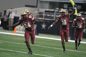 Statron Jones celebrates after his 68-yard touchdown pass at Midwestern State University v. Eastern New Mexico game at AT&T Cowboys Stadium in Arlington, Sept. 20, 2014. Photo by Lauren Roberts