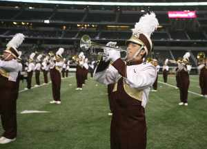 Austin Coker, freshman, marches during halftime at Midwestern State University v. Eastern New Mexico game at AT&T Cowboys Stadium in Arlington, Sept. 20, 2014. Photo by Rachel Johnson