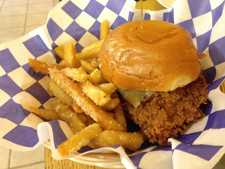 The buffalo bacon chicken sandwich served with parmesan garlic fries.