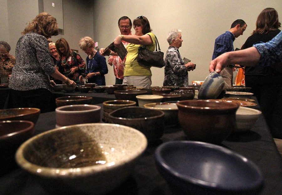 Attendees choose their bowl at the Empty Bowls event at the WIchita Falls Museum of Art at MSU Tuesday afternoon. Photo by Lauren Roberts