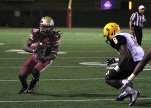 Levy Wilson, junior wide receiver, runs after the catch before being pushed out of bounds in the game between Midwestern State University and Texas A&M-Commerce, Oct. 25, 2014 at Memorial Stadium. Photo by Lauren Roberts