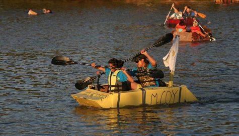 Engineering students in their cardboard boat