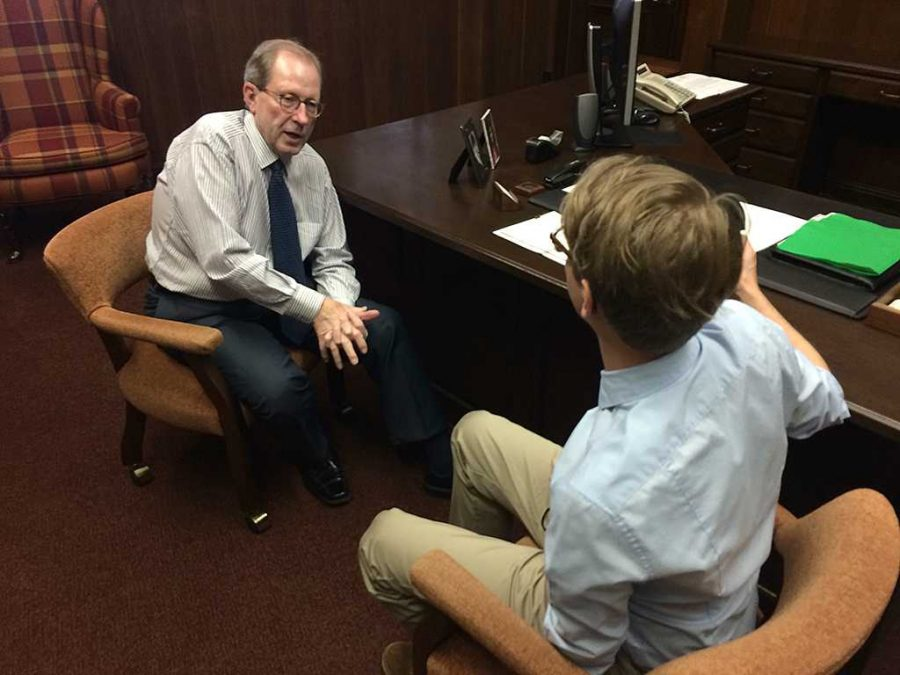 Ethan Metcalf interviews University President Jesse Rogers for the first podcast. Photo by Bradley Wilson